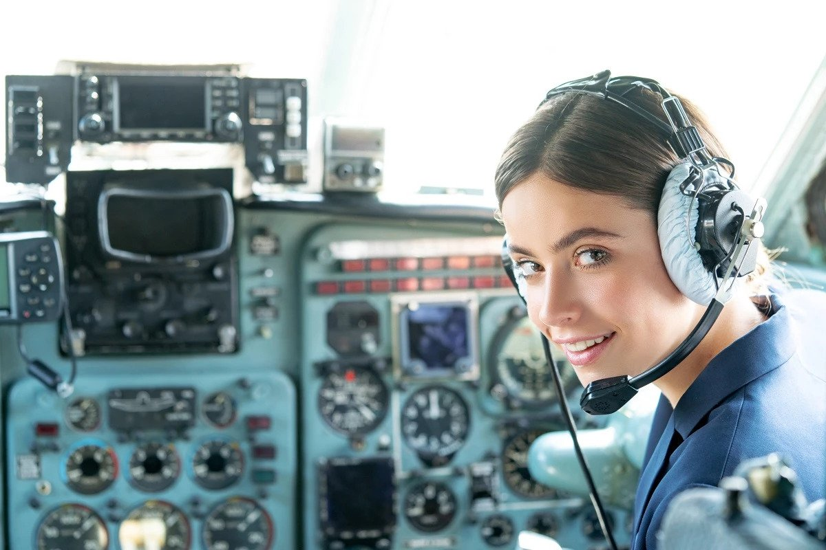 Female pilot is posing for picture