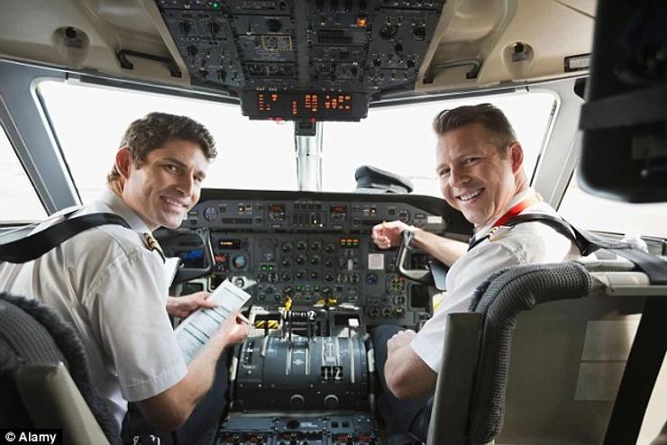Pilot co-pilot posing for picture