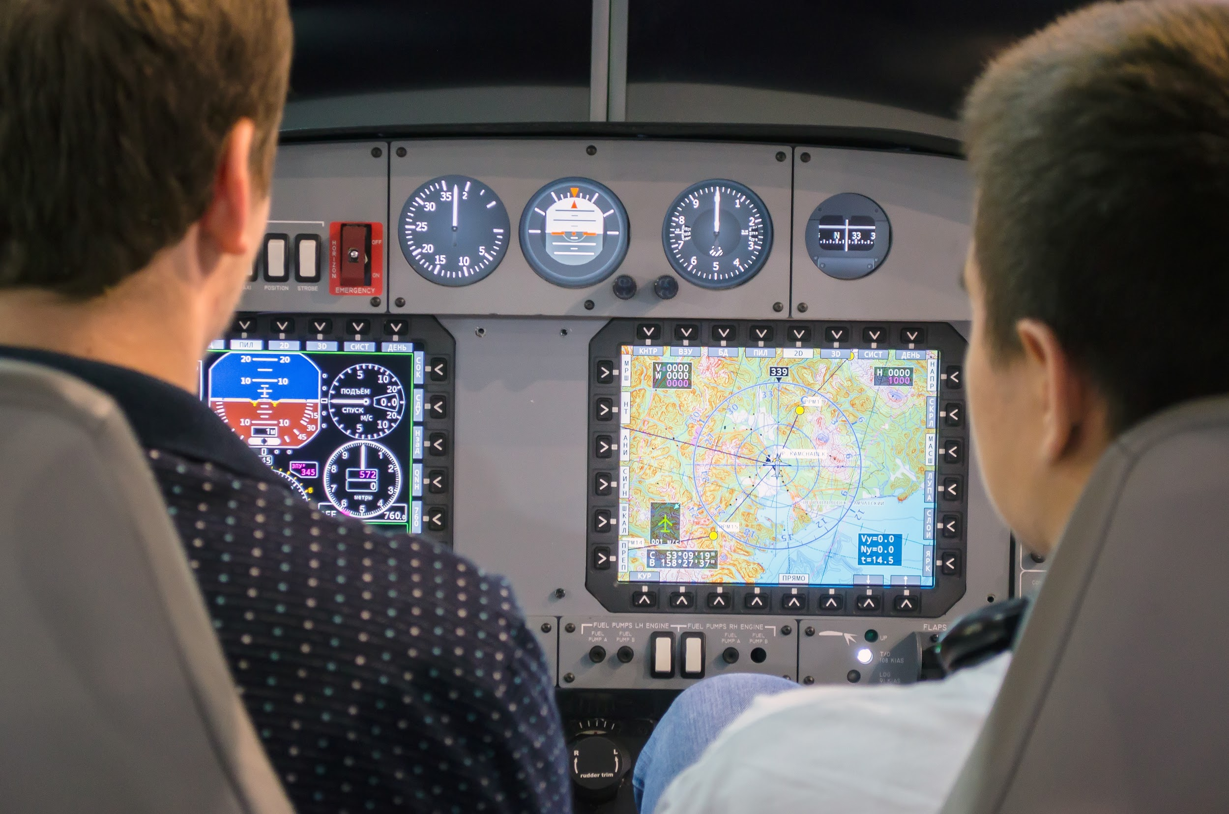 Simulator of a passenger aircraft with a cockpit and pilots