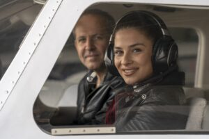 young woman trainee pilot with headset preparing to fly
