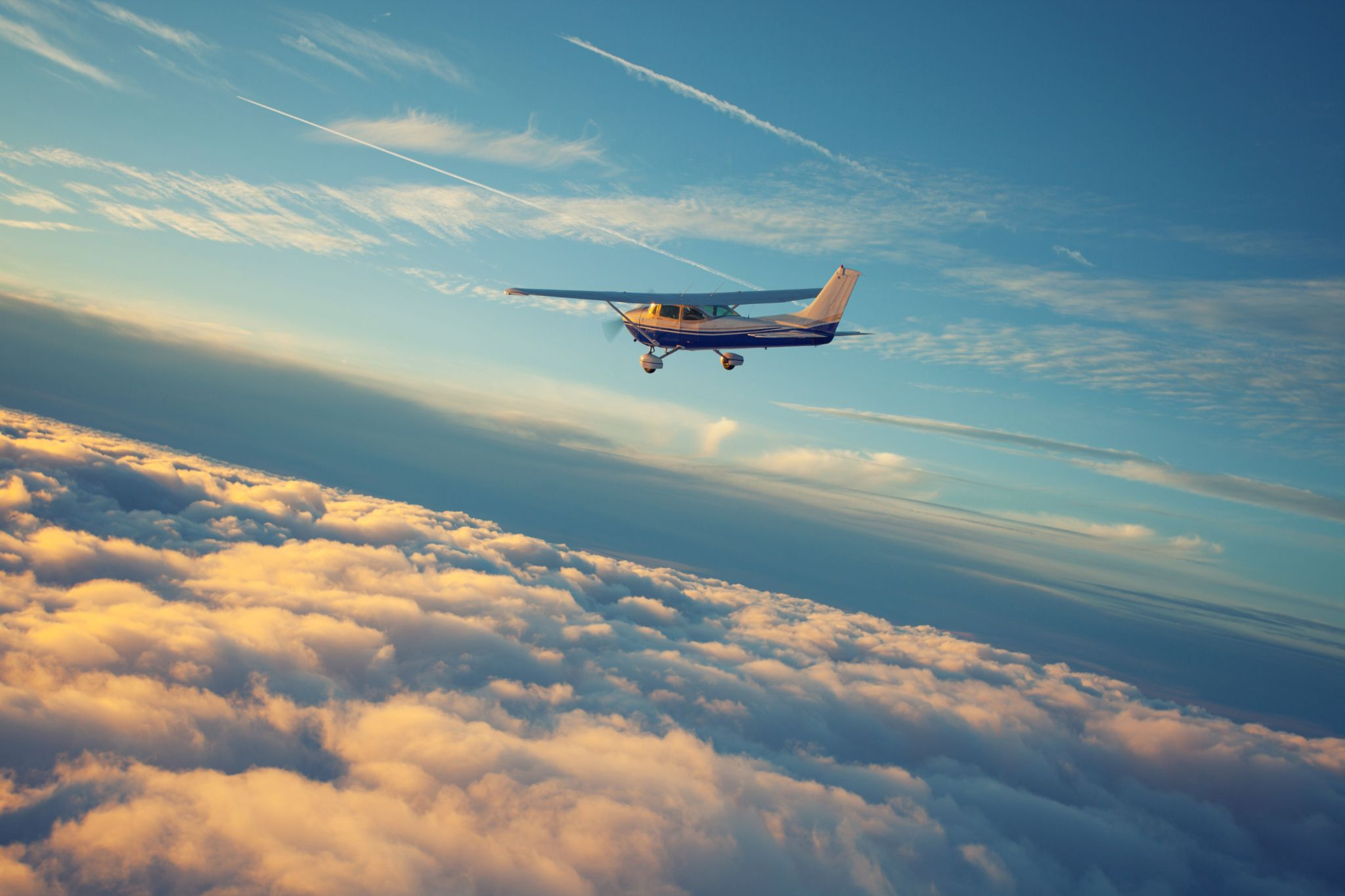 single engine airplane flying in the sunset