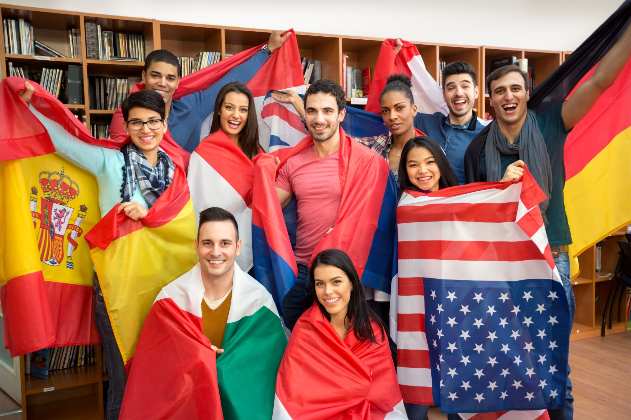 happy students presenting their countries with flags